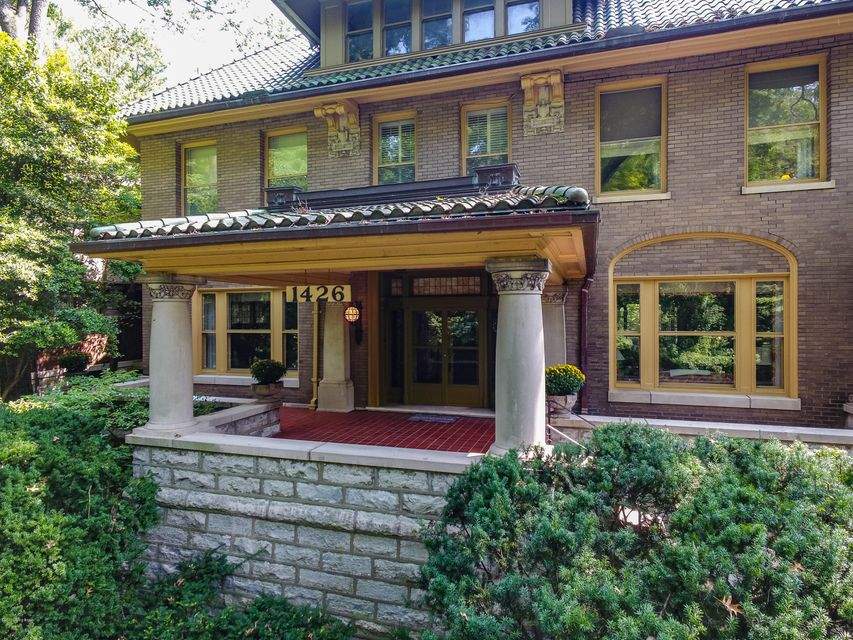 All of the amazing workmanship that was customary of the iconic homes built along Cherokee Park in the early 1900's is still present and beautifully preserved here. You'll enjoy views of nature from every window and find serene walks in Cherokee Park, just steps away. The expansive front porch, classic design and striking green tile roof set...