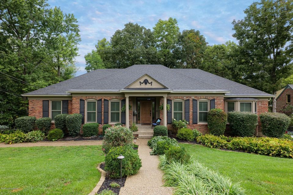 Quintessential brick ranch in Indian Hills with incredible park-like views out of virtually every window. Inviting entry foyer with hardwood floors, leading you into the formal living room, with intricate millwork, including crown molding and plantation shutters on the updated windows. Formal dining that can seat 12, all adjacent to the absolutely...
