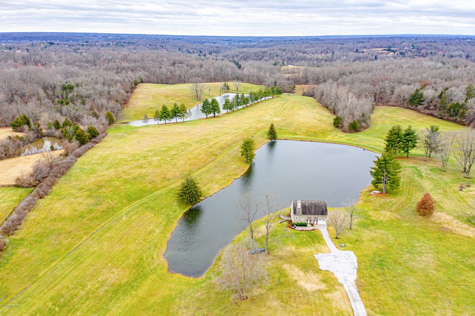 DEVELOPMENT POTENTIAL! 53.59 +/- Acres (price per acre: $$74,638) -Zoned R-4 - Currently allows 4.84 units per acre. Property features 2 stocked lakes (2.0 acres & 2.5 acres, 25ft & 36ft deep). Excellent topography - suitable for Residential Development. Easy Access to I-265 and I-64 & minutes away from shopping, restaurants, Parklands of Floyds Fork, Valhalla Golf Club, Bluegrass Industrial Park, & more. In the Path of Sewer Expansion. Parcel #1; consists of 5.0800 acres of R-4, this parcel includes a single family residence w/2 car garage (5,097 total SF), barn w/ separate geothermal HVAC/electrical/bath (1,393 SF), shed (770 SF) & three-sided shed (2,758 SF) originally constructed in 1957. Parcel #2; consists of 48.5088 Acres of R-4 land, this parcel includes a single family