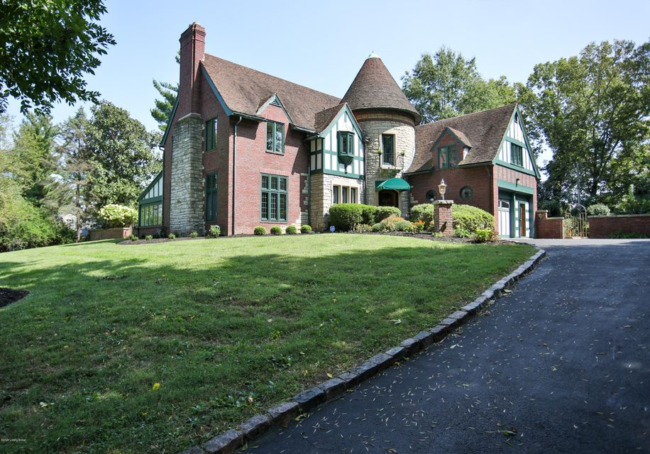 A piece of history can be yours in the heart of Indian Hills. This beautiful Tudor home was designed and built in 1929 by famed architect Ossian P. Ward as his residence. You walk into the entrance and foyer and find yourself in a turret with a graceful winding staircase. Original hardwood floors throughout the first floor (with the exception of the kitchen). The Living Room has a fireplace, built-in bookcases and French doors, which open to a comfortably enclosed sunroom or home office with an abundance of light and tranquility. The Formal Dining Room is just off the eat-in kitchen with a walk-in pantry and island. In this large kitchen, you will also find original built-in cabinetry for china, crystal or silver. There is also an additional closet for storage.