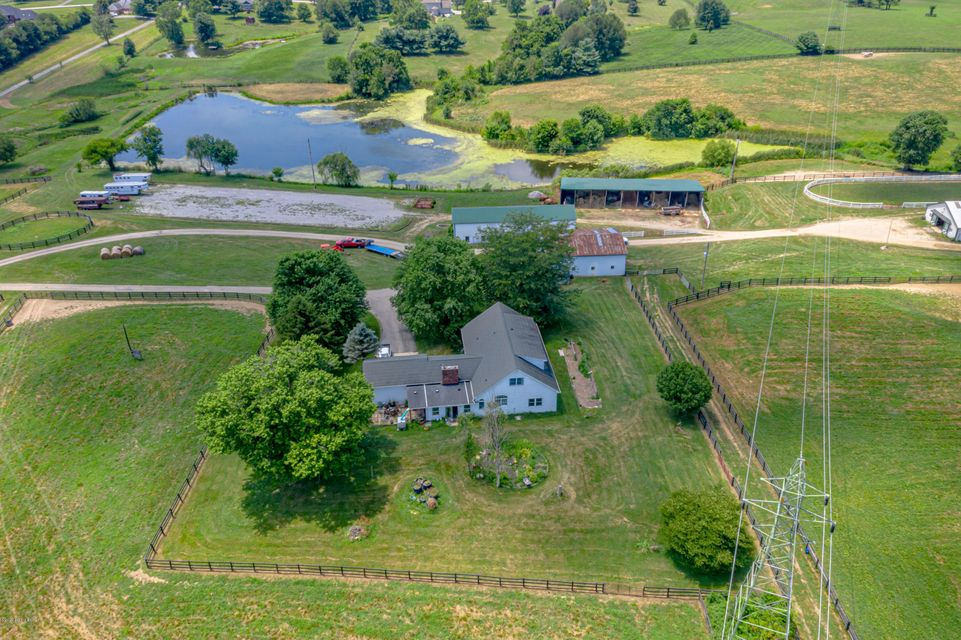Beautiful horse farm in great location close to the Simpsonville exit. This farm has 3 homes located on it, the main house, tenant house over looking lake and trainer house. The main horse barn has 16 large stalls with rubber mats, tack, feed room, wash and groom rack and office, another horse barn has 7 stalls and newer roof and machinery...