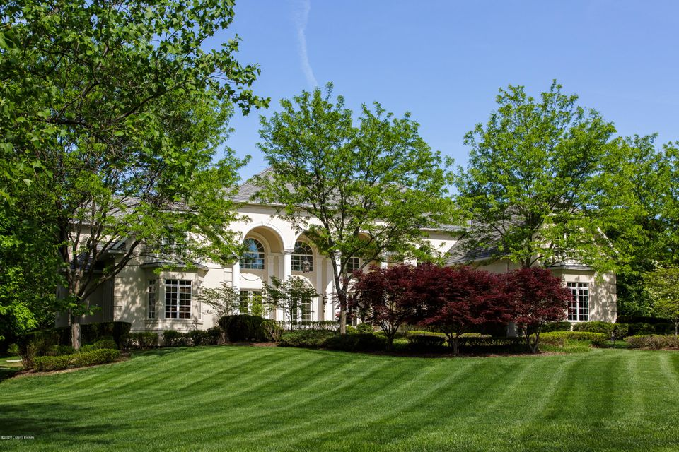 Situated among mature trees and sprawling acreage within Louisville's most idyllic neighborhood, this stunning estate home offers nearly 10,000 square feet of luxurious custom-built living space in a private parklike setting. Nestled on an exclusive drive within the award-winning Anchorage School District, the 2.3 acre estate features beautifully...
