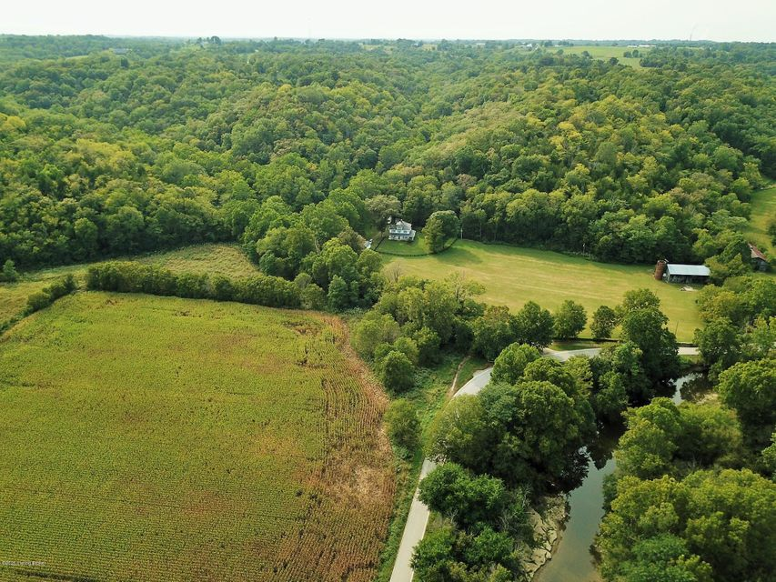 If you have dreamed of owning a pristine Kentucky farm complete with an old stone fence, two creeks, frontage on the Little Ky River and a beautifully renovated Pre-Civil War historic farmhouse..... then this property may be just the place for you! This rare gem of a property is nestled in a peaceful little valley and centrally located between...
