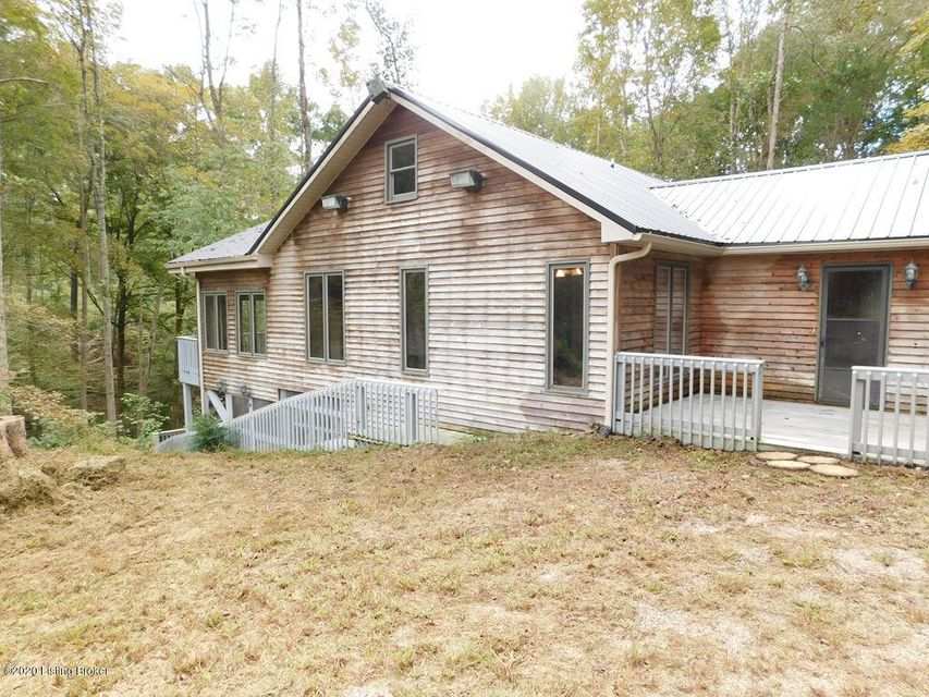 Motivated Seller! Looking for a cabin in the woods and on the lake? Check this one out - 2 bedrooms, 2 1/2 bath, screened porch, wood deck, wood stairs to creek, redwood siding and one side backs up to Corp Property. Also has a 1600 SF barn with concrete floor and electric, buried utilities and 14.66 acres. Boat slip with Corp of Engineers approval. Owner is willing to sell the 3 lots separately. Lot 1 is 2.8 acres on corner, Lot 2 is with house, barn and almost 7 acres, Lot 3 is ridge, 5 acres, with potential building site on Lake Front. Call agent for details.