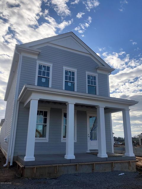 Fabulous two story plan by Joe Kroll Builder.  The front porch welcomes you into the open first floor with a large living room with a cozy fireplace surrounded by built in cabinets.  The living room space flows into the kitchen, dining area and then out to the covered side porch.  The pantry with custom wood shelving is just off the kitchen...
