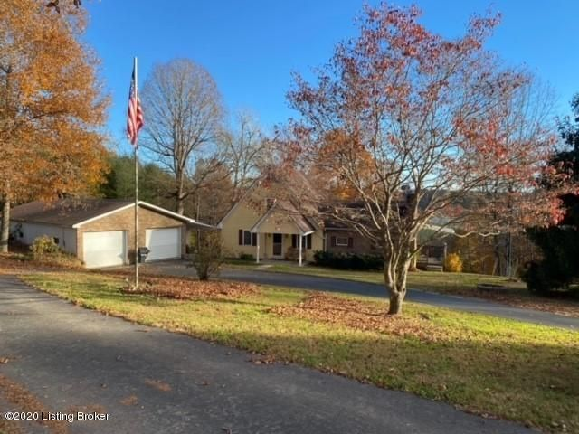 Country charm at it best with stunning views all around. When you turn on to the long paved drive you will begin to see why you would want to move your family to this 3 bedroom 2.5 bath A frame home on 2.5 + acres. Country living just 2 miles from the city and amenities. Large great room for hosting your family gatherings with great views  The kitchen has nice appliances with black refrigerator, stove, microwave, dishwasher and trash compactor.  Main bedroom is on the first floor with a full bath attached. There are 2 large bedrooms and half bath on the second floor with access to a large storage attic.  The 28x52 detached garage is large enough to hold 4 vehicles as well as plenty of room for your work shop or farm toys. The home is move in ready!