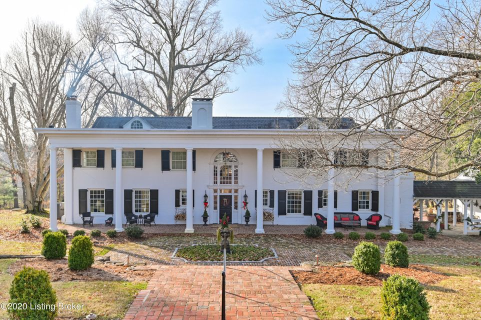 This distinctive estate is located on one of the best sites in Jefferson County and includes almost 8 acres.. The private drive is easily recognizable with the waterfall from the spring fed pond as you enter the property. This home features many updates and amenities including a lighted tennis court, pool with pool house, as well as a barn...