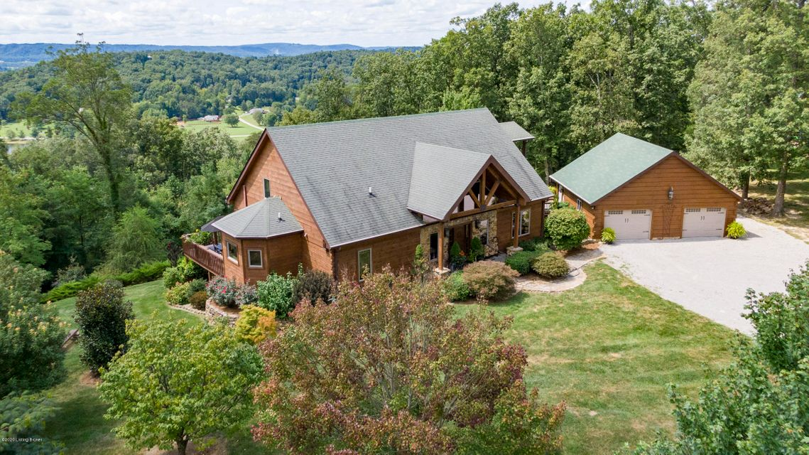 Head for the Hills! A secret treasure located 20 minutes from Downtown Louisville.  Luxurious wood-sided custom built home nestled on 1.8 acres adjacent to the Bernheim Forest will make every day feel like being away at a relaxing retreat.  Since this home is in the tourist corridor on The Bourbon Trail , minutes from Jim Beam and Four Roses,...
