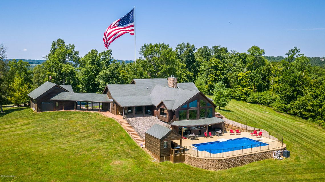 UNIQUE lake home with a Million Dollar VIEW!  For anyone familiar with Rough River Lake, you know of the iconic location of this stunning custom builder's private home overlooking the lake at Patriots Pointe.  Driving up the private road, that amazing flag comes into view - glorious in it's size and beauty. As you crest the hill - that PANORAMIC...