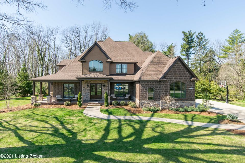 Nestled between mature trees and stunning acreage in Glenview Park, this custom-built stone and brick two-story offers a sophisticated warmth with luxurious finishes throughout, designed to compliment the natural beauty of its parklike surroundings. The main level features an inviting open floor plan with freshly painted interiors, dark hardwoods with newly installed marbled flooring, and soaring ceilings with oversize windows showcasing the stunning scenery and natural light throughout. From the welcoming great room with rich coffered ceiling, gas fireplace, and built-in bookcases to the French Country kitchen and hearth room with stone fireplace and eye-catching coffered ceiling, the first floor is designed for effortless entertaining. Whether enjoying the formal dining room, corner