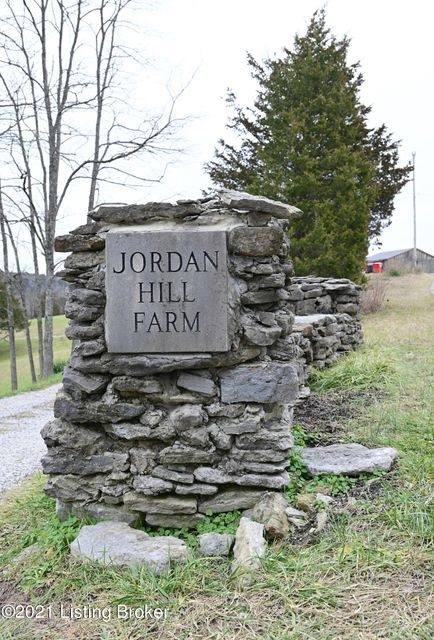 Jordan Hill Farm is 85+ acres of bucolic Kentucky countryside.  Located just outside of Richmond, KY this property will take your breath away.  The views and vistas are quite something to behold. Currently being operated as a wedding venue and airbnb getaway, the true possibilities are endless.  The rolling hills with rich soil and native grasses, nature trails, creeks, rock walls and massive tree canopy will not disappoint.  The main residence has plenty of beds/baths to accomodate you and your guests as well as quiet spaces to read and stay comfy fireside in the living room, study/library or swing on the front porch.  The kitchen has a commercial stove and appliances as well as abundant prep space for the purpose of a bed and breakfast if desired.  There is also a studio/loft over the