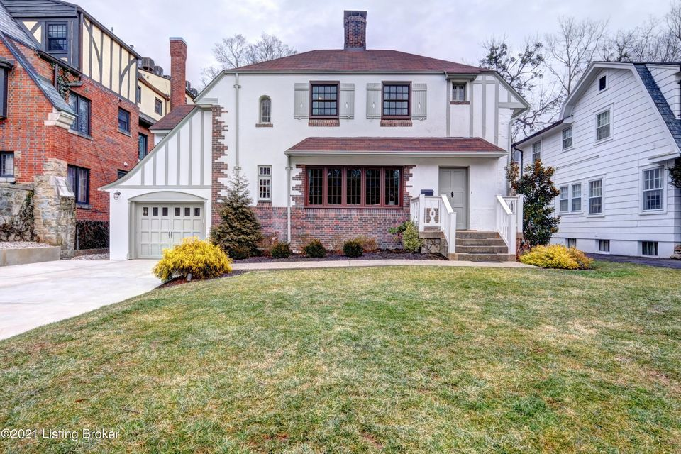 Just a short walk to Cherokee Park, this Renovated 2 Story Highlands Home, is loaded with Old World Character & A DECORATOR'S DREAM - As you enter the spacious entry way you immediately feel the brightness and the charm of this home - Hardwood floors flow throughout - Large living room with Exquisite Crown molding, Built-in Shelving surrounding...