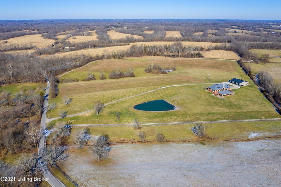 Welcome Home to Webb Rd, Simpsonville! Have it all! Location, Acreage, Picture Perfect Views, Stocked Fresh water Ponds, State of the Art Custom Out Building, Theater Room, Dry Sauna, Exercise Room and Enjoy your private Sunrise and Sunset from your Salt Water Pool year round. Live in KY Saddlebred & Hunt Country. Exceptional Custom Brick...