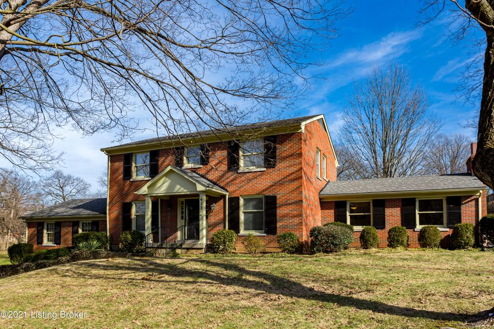Motivated Seller! This adorable, brick colonial boasts almost an acre lot near Seneca Park, schools, interstate & more. A spectacular drive-way wraps around to the 2.5 car garage and provides additional parking & turn about. The 1st floor showcases stunning hardwood floors, beautiful natural light and updated half bath. An oversized living room with fireplace is perfect for relaxing or entertaining family & friends. The kitchen opens to a hearth room with fireplace and sliding glass doors overlooking the yard. Bedrooms feature gorgeous hardwood flooring and large closets. A spacious, ensuite primary with walk-in closet adds to the appeal. The basement has a family room, partial bath and exterior door as well as bonus room and laundry. Let your imagination run with this oasis in the city!