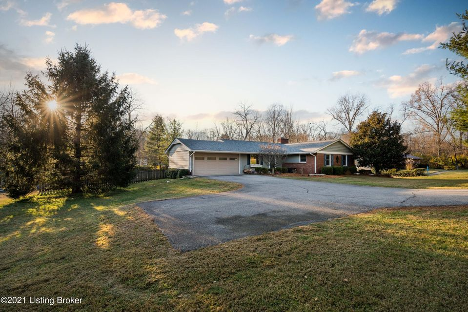 Open Updated and spacious walkout ranch on .83 acres in St Matthews offering an open floor plan with 4 bedrooms, 3 full bathrooms, 2 wood burning fireplaces and a 2-car attached garage! The main floor has been beautifully opened converting a sunroom into a more usable and finished living space while also adding a custom-built 7' x 5' butcherblock...