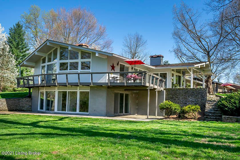 This iconic mid-century modern had a four page spread in the CJ in 1964. It's THAT house you walk by in the park and dream it could be yours. The wrap around porch overlooks a huge yard to beargrass creek and the stone bridge. Seneca golf course along the back gives you the privacy to enjoy your floor to ceiling windows to feel inside nature...