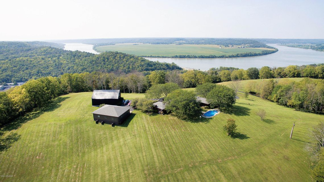 Stunning 165 acres with panoramic views of the largest horse-shoe bend in the Ohio River*Meticulously maintained year round, some of the best acreage available in NKY*Extremely private country living*Property features a beautiful Mid-Century Modern Ranch offering serene river views from almost every room, an in-ground pool, massive garage...