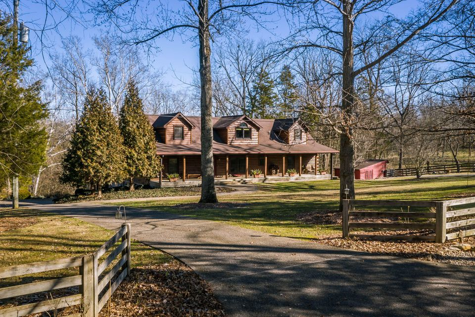 Custom built in 2003, this magnificent log house is nestled on 3.3 acres with woods and a creek meandering through in one of the most desirable locations.  Mayo Lane is a quiet, tree-lined country lane just outside of Jefferson County in Oldham County, home of wonderful schools and beautiful horse properties.  Once inside, you're sure to love...