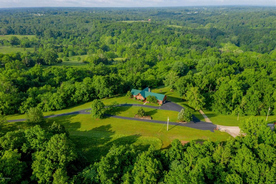 145 ACRE FARM! Time to enjoy miles of 4-wheeling, hiking trails, fishing and deer hunting all in one place. Custom built log home, over 3000 sq ft plus 1500 sq ft in finished walkout basement. Look out over 145 acres connected to some of the last continuous hard woods in Central KY and watch the wildlife come alive. This farm offers a well stocked small lake, a built to specs automatic trap and skeet range, plus miles of exciting ATV/hiking trails to explore. Log home offers rustic open floor plan, 2 hand laid fireplaces with large family room and Kitchen area.