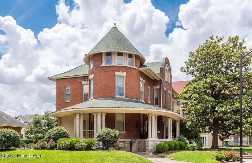 Elegant condo located in the historic building known as ''The Round House''.  Wonderful architectural details with a round living room located in the turret with decorative fireplace, ornate columns, classic inlaid wood floors and extensive moldings on the ceiling and on the classic columns.  This unit has it's own personal laundry in basement...