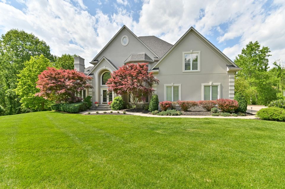 This outstanding home is surrounded by mature landscaping and sits on 1.5 acres on a quiet cul-de-sac in the Estates of Hunting Creek. The back of the home looks out onto the lush woodlands, providing privacy and serenity to the pool and decks. You'll find many options for gracious outdoor entertaining here with access to outdoor ''rooms''...