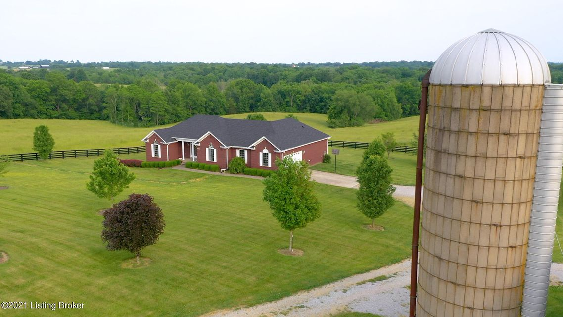 Wow! Fantastic opportunity to enjoy these 118 acres +/- beautiful farm within 50 miles from Louisville and 65 miles to Lexington or Cincinnati! Gorgeous 4-bedroom custom built brick walkout ranch with finished basement. After stepping into the entry, you notice the abundance of natural light.  The Great room features a corner gas fireplace...