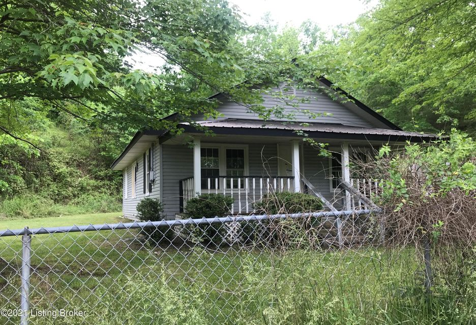 Don't miss the opportunity to purchase this fixer-upper property.  Bungalow style home with metal roof. Covered front and back porches. Detached 2 car garage. Cash offers only! Sold ''as is'' and ''where is''.