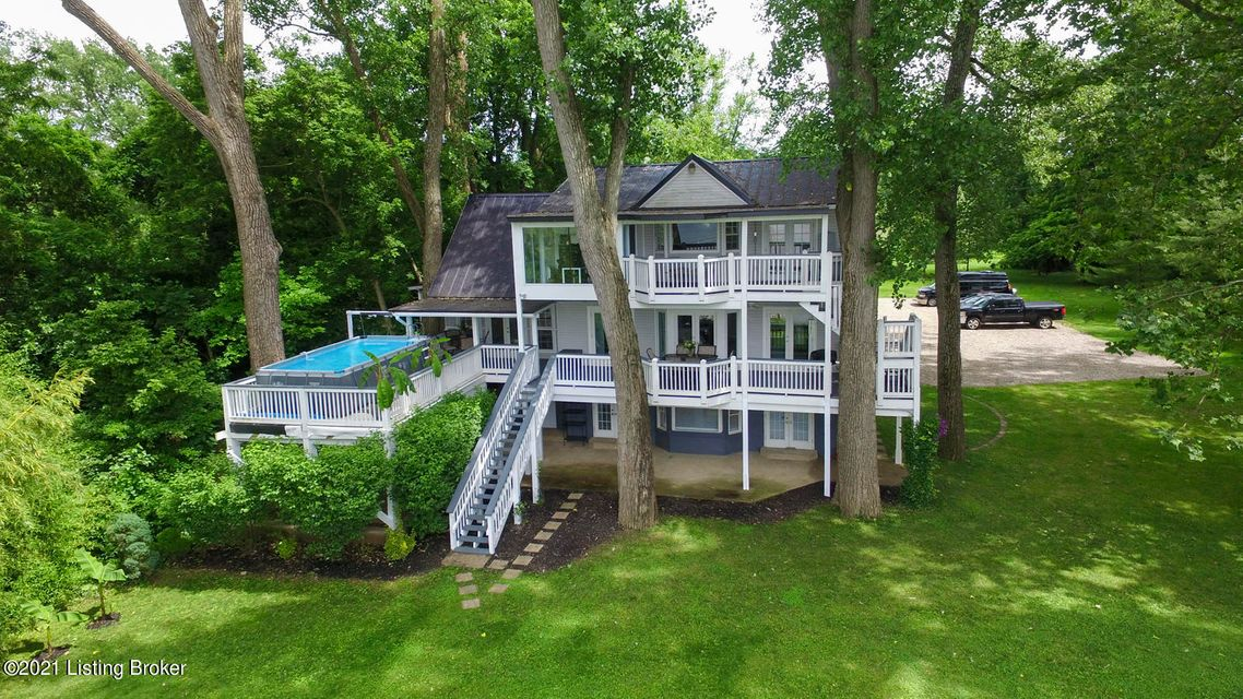 Unbelievable opportunity to own your own private river front retreat, that's only minutes from fine dining, major expressways and downtown Louisville. This gorgeous contemporary waterfront home and expansive lot is a vacation home you can truly live in everyday. Breathtaking views of the Ohio river from three different floors both inside and...