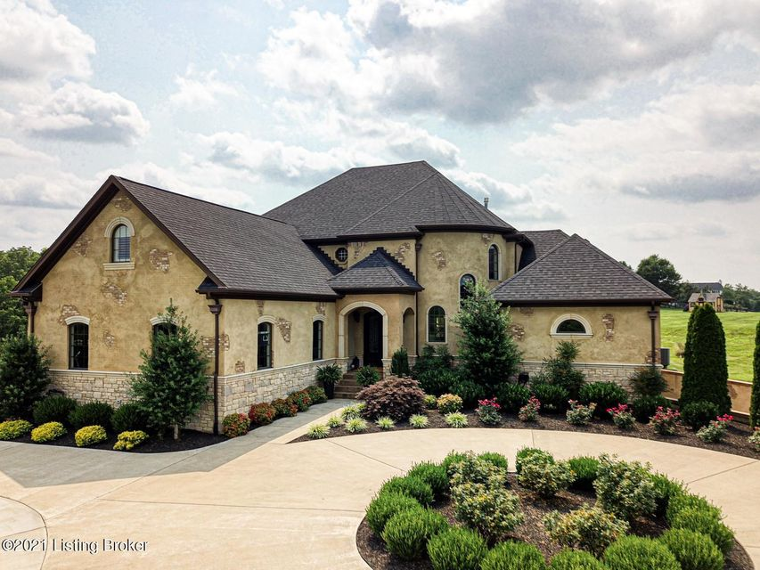 Welcome home -This exclusive home is in a fabulous gated community in Simpsonville, Kentucky. This custom built masterpiece featuring the finest finishes imaginable completed with a special consideration of today's most luxurious style and sought after design. Upon arrival you are greeted with a circular driveway and lovely entry way.  The home is featuring exquisite inlays, lavish millwork, soaring arched doorways and elaborate ceiling details. Each room has been meticulously designed to offer an unprecedented custom-built experience.  The entry way when guests arrive into the two-story foyer with a beautifully designed staircase leading to the magnificent 2nd floor. The gourmet kitchen is perfect for all of your entertaining needs