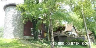 Welcome to your own piece of paradise in this rural setting that has 42 acres.  The home has 4000 sq ft. The original A Frame was built in 1971 and the room addition was built in 2009. A large metal pole barn, two ponds, a playground, a gazebo and a 14'x20' cabin with electric and storage building. This home has so much character. The moment...