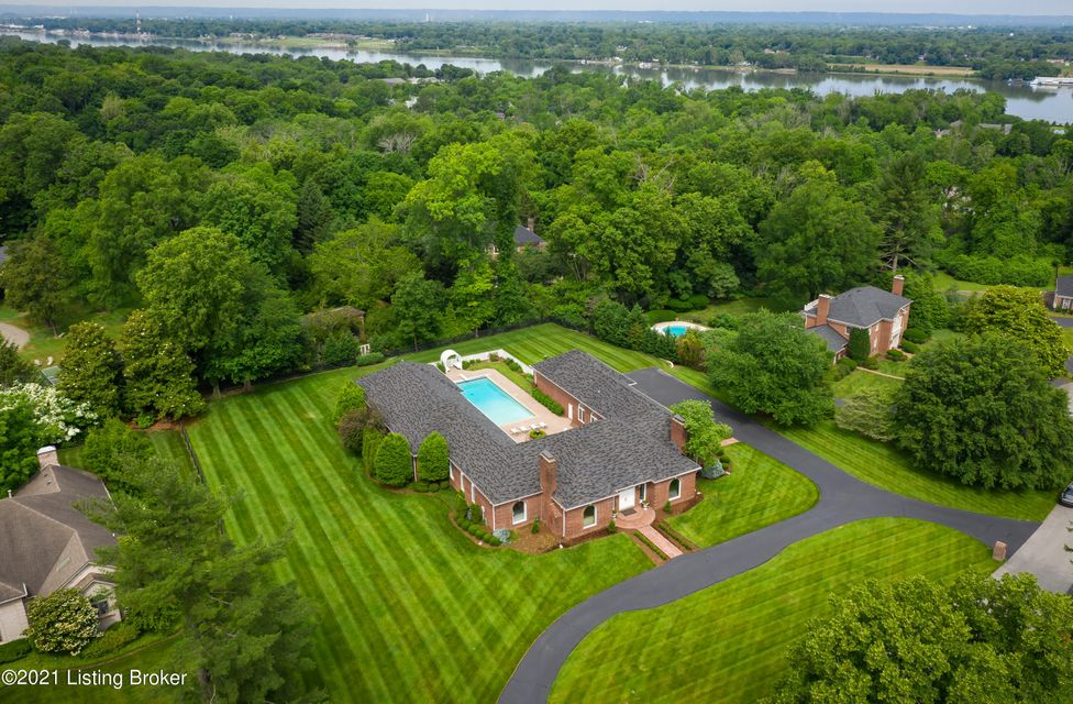 Elegant custom built Poplar Crest estate provides the ultimate private first floor living experience. This house features 4 bedroom suites, 6 full baths, a whole house generator, a large private gym, a heated 3 car garage, and a swimming pool. Upon entering the home you'll find the spacious marble tiled floor flanked by a wood paneled office...