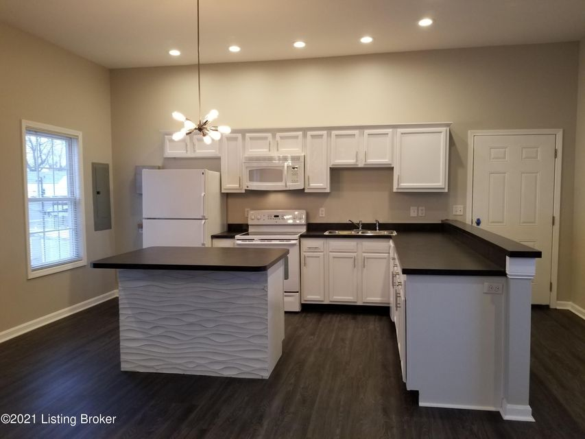 Tell Your Landlord That You Found a Lease-Breaker! Open, 2nd Floor, 2 Bedrooms, 1 Bath, OPEN Floor Plan in Germantown! This RECENTLY RENOVATED Apartment in on the Second Floor and Has an Amazing Living Space with Remote Controlled Fireplace, Hard Wood Style Floors, PLENTY of Natural Light, Range, Refrigerator, Above-Range Microwave, Dishwasher AND Washer / Dryer. Tiled Tub Surround with Mosaic Inlay and Espresso Vanity with Beautiful Sink. Spacious Master Bedroom and Nice Second Bedroom. Ceiling Fan, Kitchen Island, Utility Room, and Foyer. Large Deck Overlooks Germantown and is in Walking Distance to Eateries, and Entertainment! No Smoking. Pet Friendly with $350 Non-Refundable Pet Fee and $25/Month Pet Rent. Must Be 21 Years of Age. Water, Sewer, and Trash is Included. Tenant Pays
