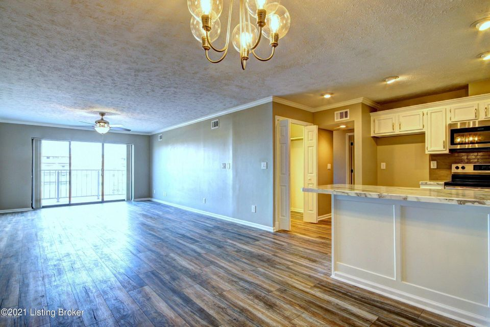 This beautiful condo has over 1100 sq ft.  Renovated in 2018. Open floor plan. Spacious living room that leads to the balcony. Living room flows into the dining area and open and light beautiful kitchen. Newer cabinets with tile backsplash and marble style countertops. Plenty of cabinets and countertops including a large breakfast bar.  Spacious pantry.  Stainless steel Frigidaire appliances to remain that includes the refrigerator, stove, dishwasher and microwave. The Primary bedroom includes a ceiling fan, walk in closet, and a full bath with an extra-long vanity top.  There is an additional bedroom and another full bathroom off the hallway. Newer flooring thru-out  Separate laundry room with a combo washer and dryer to remain as well. You have your own detached covered carport as well.
