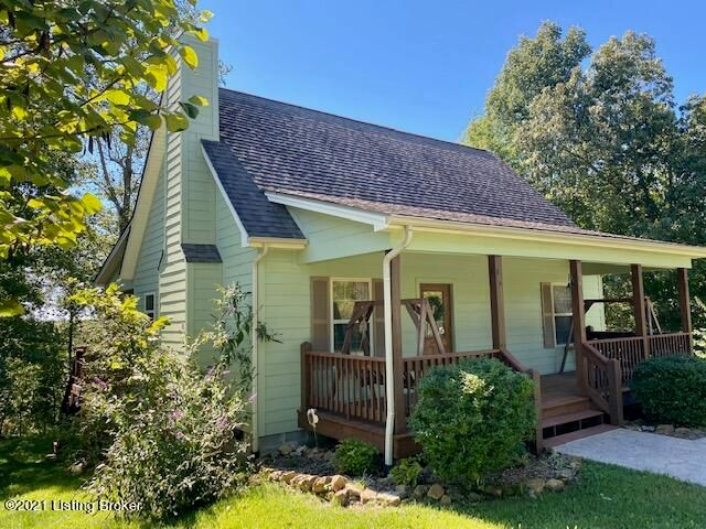 This cute, cozy home is located in the highly coveted neighborhood of Nolin Lake Estates.  This home would make a nice full time residence for someone or could be an excellent opportunity to be used as a weekend rental.  The main level has an open concept for the kitchen and living room with cathedral ceiling adorned with Knotty Pine wood....