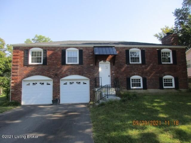 brick split level, 4 bedrooms , 3 full baths, 2 fireplaces, 2 car garage (approx 29; deep) for extra storage, hardwood and ceramic tile, patio, spacious lot , no cats.-  1 dog not over 20 pounds for a full adult dog and owner has to approve of the dog (type- bred) and only 1 dog - and a pet deposit