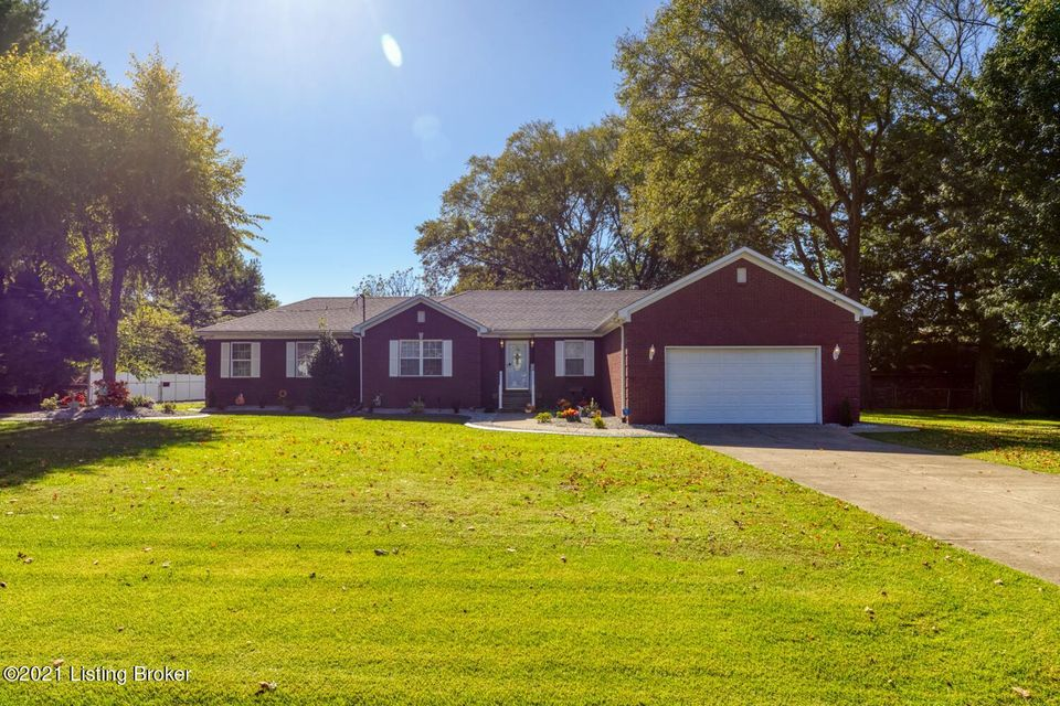 Definitely a must see! Beautiful 2011 sq ft brick Ranch with a large 35x28 building plus a 20x12 storage building. This stunning home offers 4 bedrooms, 3 full baths, take note...with 2 of the bedrooms being primary bedrooms and both having primary baths. Living room with vaulted ceiling and corner fireplace. Inviting kitchen with boasting...
