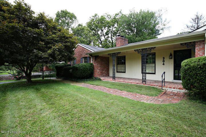 Charming brick walk to covered front porch