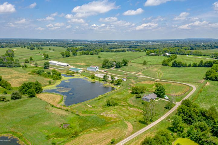 Beautiful horse farm in great location close to the Simpsonville exit.  This farm has 3 homes located on it, the main house, tenant house over looking lake and trainer house.  The main horse barn has 16 large stalls with rubber mats, tack, feed room, wash and groom rack and office, another horse barn has 7 stalls and newer roof and machinery and hay shed.  The main house (5750)on the farm is in great shape with newly remodeled master bath with walk in shower, sunroom, mud room, large great room, living room, kitchen and dining room and 4 bedrooms and Geothermal heating and air, beautiful hardwood floors, the tenant lake house (5802) is 3br 2ba and the brick trainers house (5810) is 2br (master bedrooms) 2ba, and basement and 2 car garage.  The tenant house, trainers house are both rented