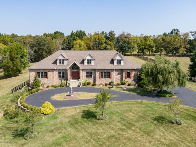 Looking for a place to spread out and roam? Welcome to 1421 Bluegrass Parkway, in LaGrange's prestigious equestrian community, L'Esprit! This custom built, two story walkout has all the amenities you could imagine. There is plenty of room here with over 5300 sqft above grade and 3200 sqft finished in the walkout basement. The main level is a light and airy, open concept. A vaulted entry foyer walks right into the main living space where Great Room, Eat-in Kitchen, Sun Room, Formal Dining Room and a Sitting Room all flow effortlessly together. The Eat-in Kitchen and Great Room were built for entertaining!