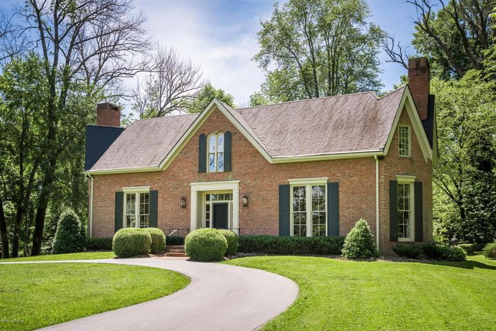 This Oldham county gem is one of a kind. Thoughtfully constructed,this brick American gothic epitomizes grace and charm but boasting all the modern amenities. Sitting atop 3 idyllic acres you enjoy golf course views, lake views and wooded views. Located 25 minutes from downtown in Oldham County and surrounded by water, woods and golf course views, this thoughtfully constructed American Gothic style brick home has much to offer. Custom built and designed by Quintin Biagi, this 5 bedroom, 4 bath home epitomizes charm and grace but has all the modern amenities with all the privacy you crave. Nestled on approximately 3 acres and privately adjoining Harmony Landing Country Club with lake, wood and golf course views. Center Hall design