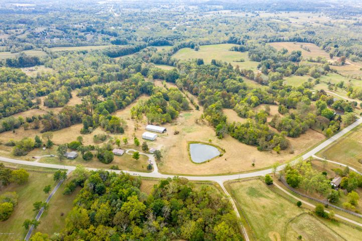 Great opportunity to purchase 52 Acres in Oldham county!!!!! This beautiful property feature a 3 bedroom, 2 bathroom Ranch home, a detached garage, and two Large Metal building ( approximately 42x62 and 40x100).conveniently located off of hwy 42  only minutes from I-71