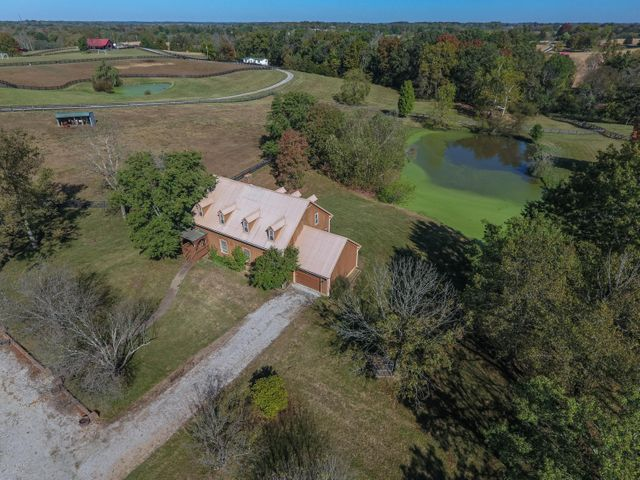 Majestic Oaks Farm is a turnkey 36+ acre equestrian facility with 23 stalls and massive indoor arena, tack, rooms, 2 full baths, bunk house, shavings storage, washer/dryer, observation deck in main 200 x 180 ft barn.  All new LED lighting for the arena and shed rows.  Arena base is 3 parts sandy loam, 1 part lime dust and cedar shavings on top.  This structure is a fortress with piers every 25ft to support beams.  the is 8 yards of concrete per pier!!!! Charming residence but in 1985 is wood frame with metal roof and has 4 BR, 2 full baths, eat in kitchen , den/living room with soaring ceilings and cozy fireplace. expansive 16 x 30 deck looks out over the pastoral fenced pastures and pond.  basement has additional storage and one of the most uniques features one might imagine.