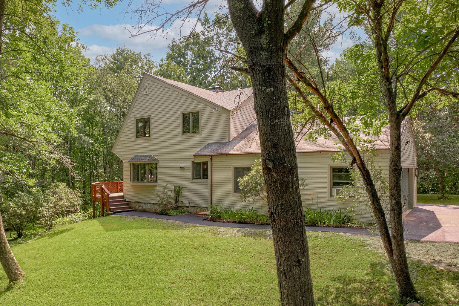 01_8 High Point_PGM_Print Front of the home with wooded private setting Show more