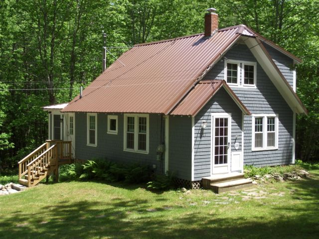 THIS SHINGLED STYLED HOME SETS ON 3 AC, A 3 story birch barn is included with a workshop.