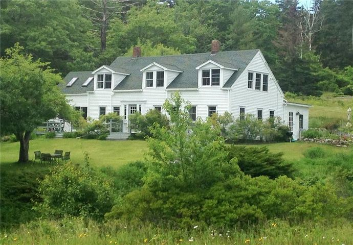 This is a beautifully cared for all season, antique Maine island cape. It is located in a very peaceful private setting, on the shore of Winter Harbor in Seal Bay. The residence has many original details including wide board floors. The landscape includes mature oaks, conifers, open fields, flowering shrubs, apple, cherry and plum trees. There are high bush blueberries, clematis, lilies and roses surrounding the residence. The open lawn sweeps down to the salt water cove with views of conserved islands. A dock, float and mooring are included. This is a magical place. The tranquil landscape and shore are a perfect place for resting, reading, writing, gardening, swimming, kayaking, sunbathing and sailing.