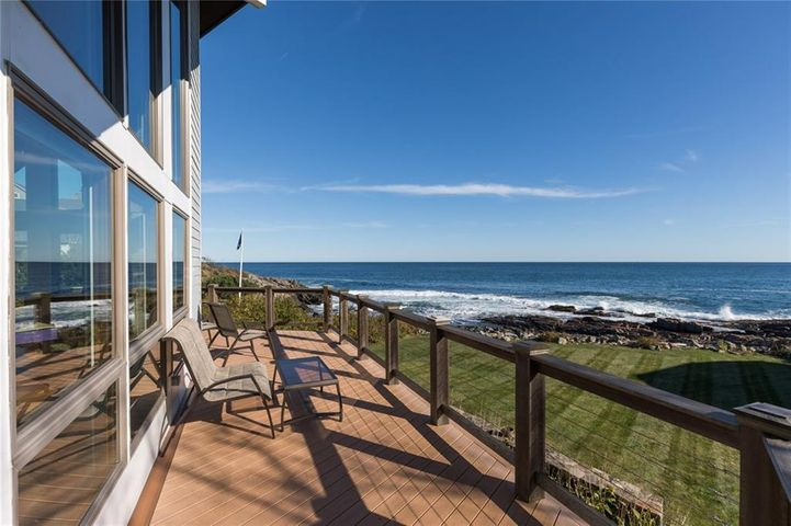 This stunning oceanfront property sits on just over a half acre with immaculate renovations throughout. A large wrap around deck provides a panoramic view of the ocean above the expansive yard that falls into the rocky Maine coastline. Large windows surround the central fireplace up to the vaulted ceiling providing open views to the Atlantic. The property's unique flexibility allows it to be used as a large single family home or as two separate units. The lower level has a large bedroom, full kitchen, full bath and sprawling views out to the ocean. The main and upper levels offer an updated kitchen spilling into a wide open floor plan with magnificent views at both levels. Two separate living spaces & full kitchens make an ideal setup for guests, family or as an income producing rental property. This property can be enjoyed in so many different ways. Truly a one of a kind opportunity that is not to be missed!