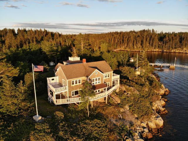 Bay Point, a year round estate cottage on a private peninsula, high ground with a deep water granite dock, including four moorings and a ramp on Seal Cove, a protected sailing bay on the Fox Island Thorofare in mid Penobscot Bay. Majestic Westerly views to the Camden Hills and surrounded on all sides by conservation land including the historic ''Swimming Pool''.  A delightful compound 40 plus acres,  2 boathouses, a shore guest cottage, a year round home with 5 bedrooms, 3 1/2 baths, a water's edge tennis court area, wrap around decks, private room decks.  Views of Perry Creek, Mouse Island, Casino and the North Haven Village and ferry terminal. Fox Island Thorofare is one of the main east-west passages on the Maine Coast for cruising vessels, a continuous ''boat show''.  A quiet quaint magical one-of- a-kind place to make  family memories and entertain your guests all year round. Great boating for the family as the cove is protected and this location is in the middle of one of the most beautiful cruising grounds in the world.  Easy access from the Vinalhaven ferry or the North Haven ferry or by air.
