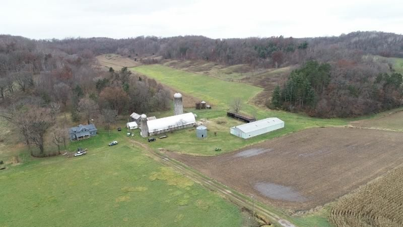 114.86+/- acre farm with improvements: 2-story farmhouse (5bdrm, 1.5 bath) with newer roof, siding, windows, plumbing & more! Home also has an adjoining 1 bdrm, 1 bath apartment. 114'x30' 50-tie stall, ''center feed'' dairy barn w/800 gal. Mueller bulk tank, 4-units and Surge pipeline, 42' x 120' machine shed, Butler 5000 bushel corn storage bin, cement feed lot, 2-stave silos and various other outbuildings. Land is approx. 55 tillable with remainder pasture & woods. Small spring in the back. This farm is also offered on 80+/- acres for $309,900.