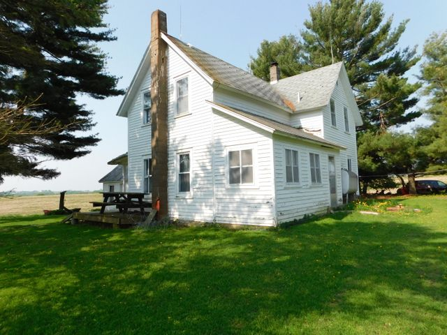 The country setting you have been waiting for! 4 bedroom 1 bath older farm house on 77.42 acres. Woods, Tillable, Spring. Outbuildings include barn. shed, and summer kitchen.  This is being offered on a Sealed Bid.   Sealed bid packets available thru listing agent and on sign at property
