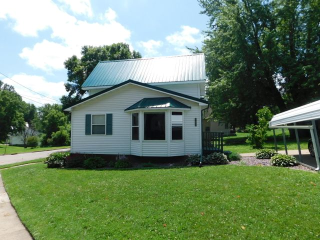 3 bedroom 1 bath home on a nice corner lot.Vinyl siding and new steel roof. Car port.  Large yard with garden and asparagus, black caps, comfrey and horseradish.